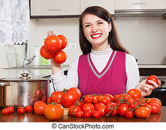 Happy woman with tomatoes
