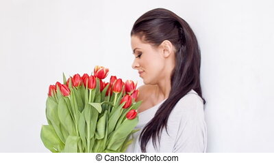 Happy Woman With Tulips Bouquet