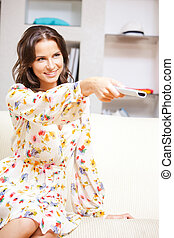 happy woman with TV remote