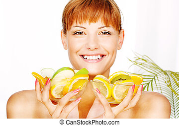 Happy woman with two fruit bowl