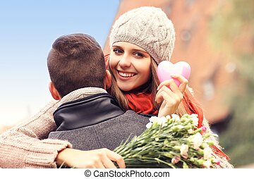 Happy woman with Valentines gift and flowers