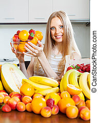 Happy woman with various fruits