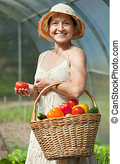 Happy  woman with vegetables harvest