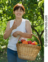 Happy  woman with vegetables