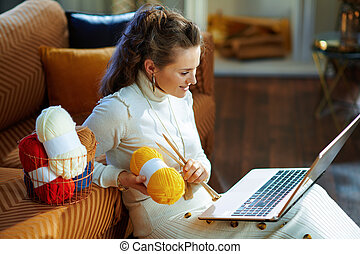 happy woman with yarn learn how to knit