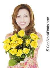 Happy woman with yellow roses