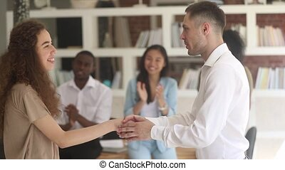 Happy woman worker student get rewarded promoted handshake boss teacher