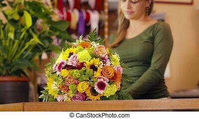 happy woman working as florist - young hispanic woman...