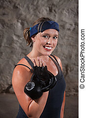 Happy Woman Working Out - Smiling young woman sweating and...