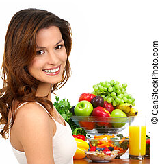 happy woman - Young smiling woman with fruits and vegetables...