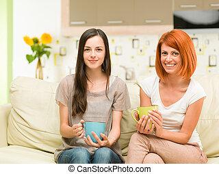 happy women drinking coffee