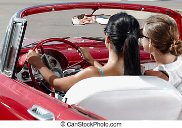 Happy Women Driving Rented Convertible Car For Vacations