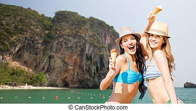 happy women eating ice cream on bali beach