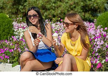 Happy women friends eating ice cream