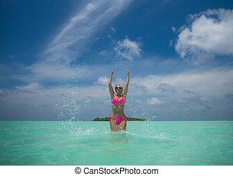 Happy women in bikini on tropical beach