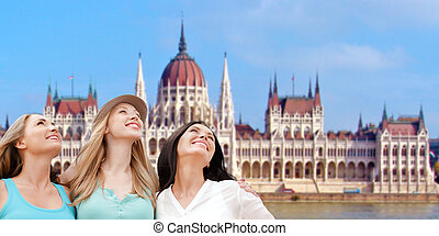 happy women over house of parliament in budapest