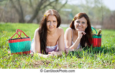 happy women relaxing in park