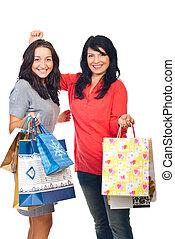 Happy women shoppers cheering