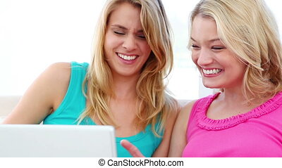 Happy women using a laptop