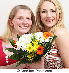 Happy women with a colourful bouquet