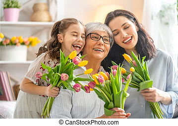 Happy women's day! Child daughter is congratulating mom and ...