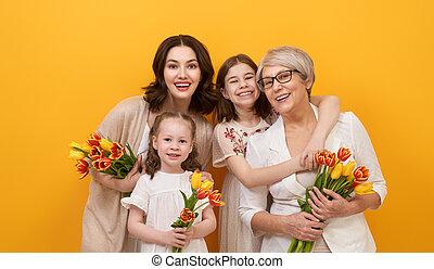 Happy women's day! Children daughters are congratulating mom...