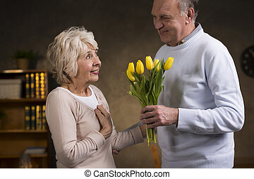 Happy women's day - Loving older man giving bunch of yellow ...