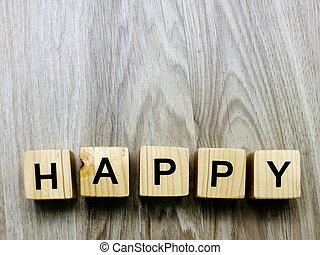 happy word wooden block on wooden background