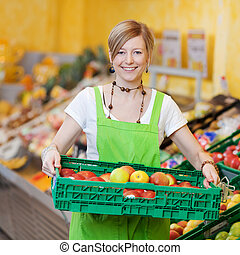 Happy worker in a supermarket - Happy female worker in a...