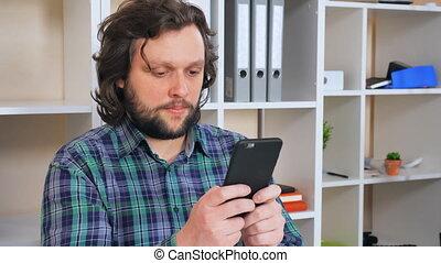happy worker messaging in office