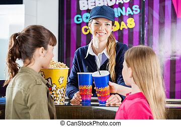 Happy Worker Selling Snacks To Girls At Concession Stand