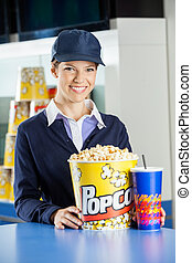 Happy Worker With Popcorn And Drink At Concession Counter