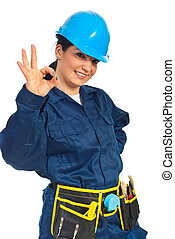 Happy constructor worker woman showing okay sign hand gesture isolated on white background