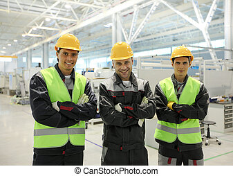 Happy workers in factory