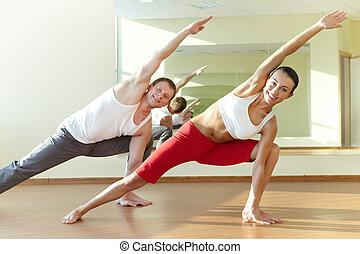 Happy workout - Image of young sporty girl and guy doing...
