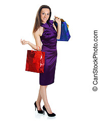 Happy young adult woman with colored bags