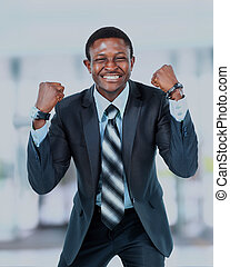 happy young african american businessman in office.