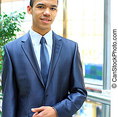 happy young african american businessman in office