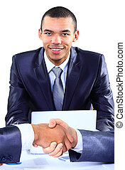 Happy  young african american businessman working on laptop computer