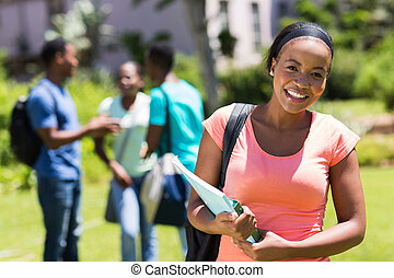 young African American college girl holding books