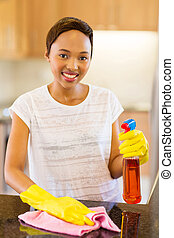 young african american woman cleaning kitchen counter