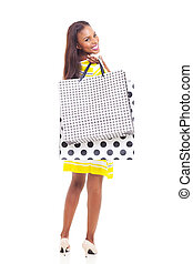 young african american woman holding shopping bags