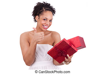 Happy young African American woman opening a gift box