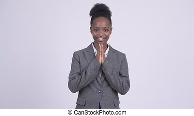 Happy young African businesswoman greeting with respect in...