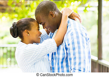 african couple embracing