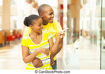 african couple shopping in mall