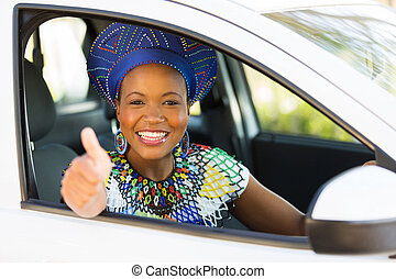 young african female driver giving thumb up
