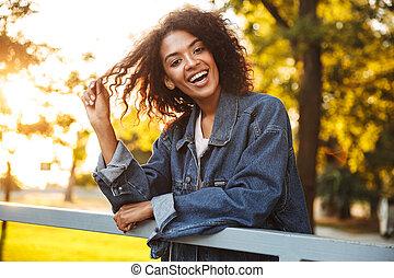 Happy young african girl in denim jacket