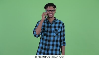 Happy young African hipster man talking on the phone - ...
