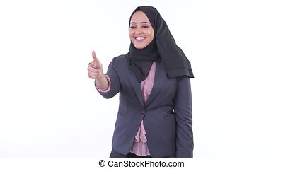 Happy young African Muslim businesswoman giving thumbs up -...